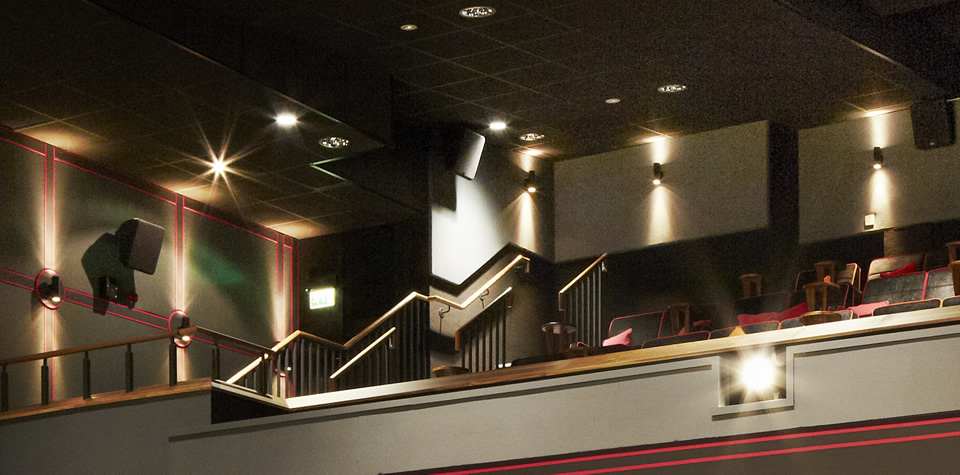 An image of the inside of the Everyman cinema in Leeds, after refurbishment, showing lay-in grid ceilings.