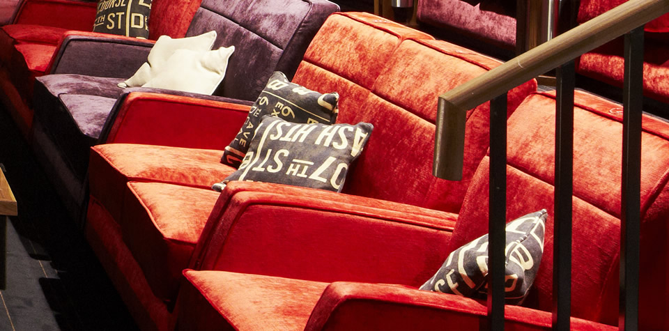 A close of image of sofas and cushions inside the Everyman cinema, after refurbishment.