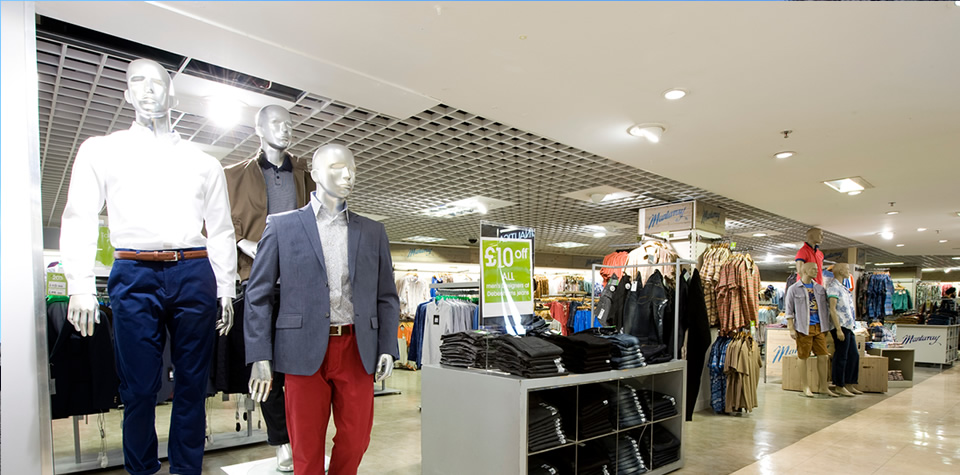 An image of semi-concealed grid ceilings, plasterboard ceilings, feature bulkheads, and GRG lighting troughs in Debenhams, Oxford Street, by Construction Design Ltd.