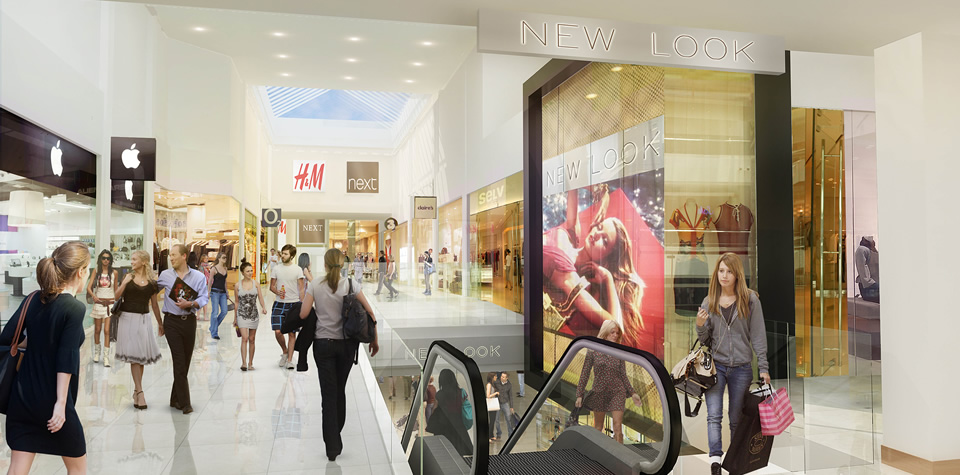 An image of the inside of a shopping mall, showing Next and H&M units, following on from a reconfiguration and refurbishment.