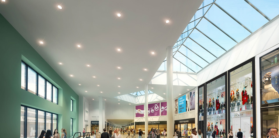 An image showing MF feature ceilings and bulkheads and lay-in grid suspended ceilings inside Waterside Shopping Centre.