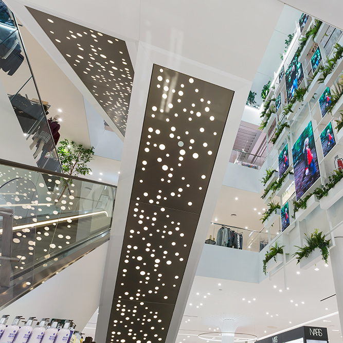 An image of a escalators in a shopping centre where Construction Interior Design used metal stud partitioning.