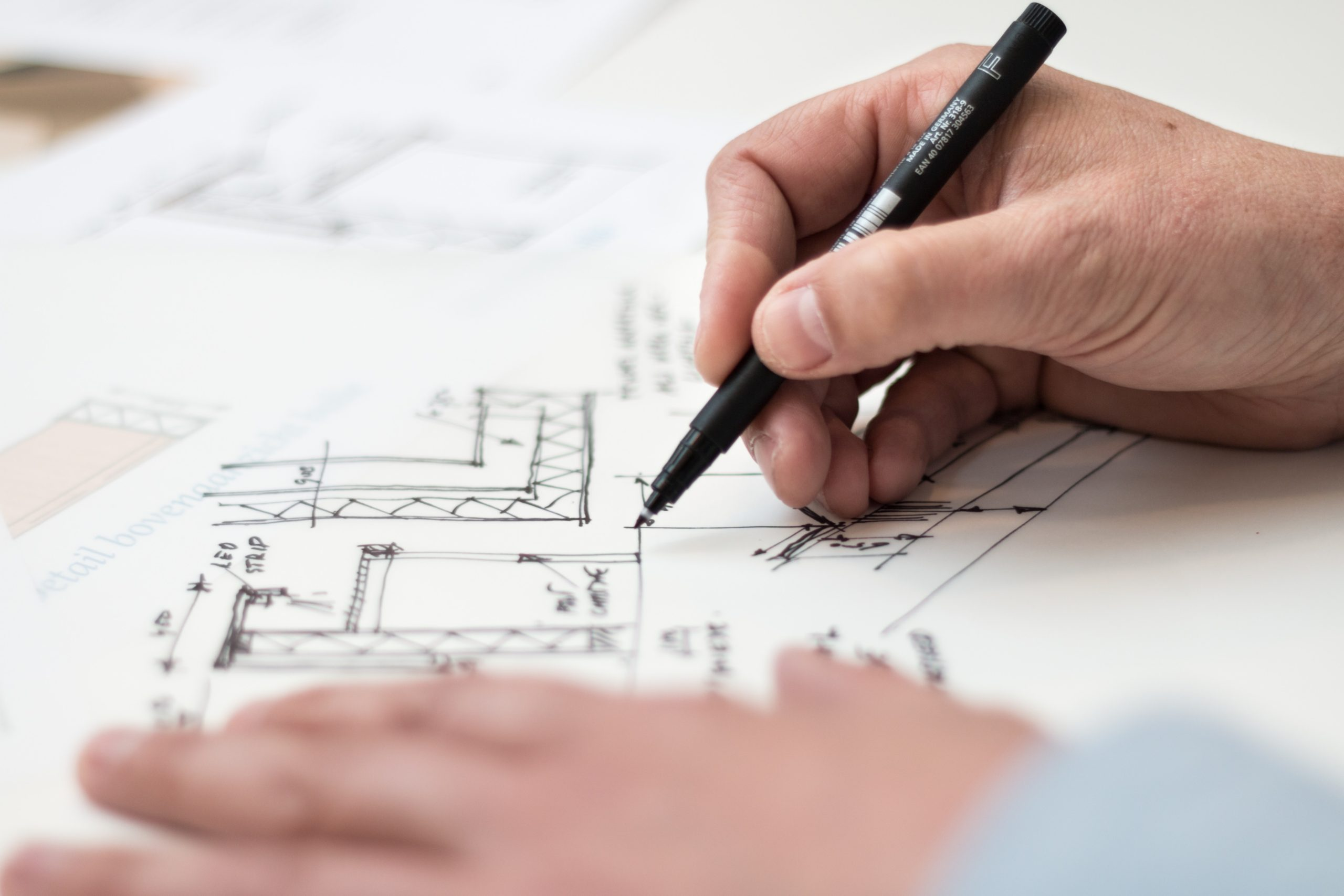 An image of someone working on floor plans