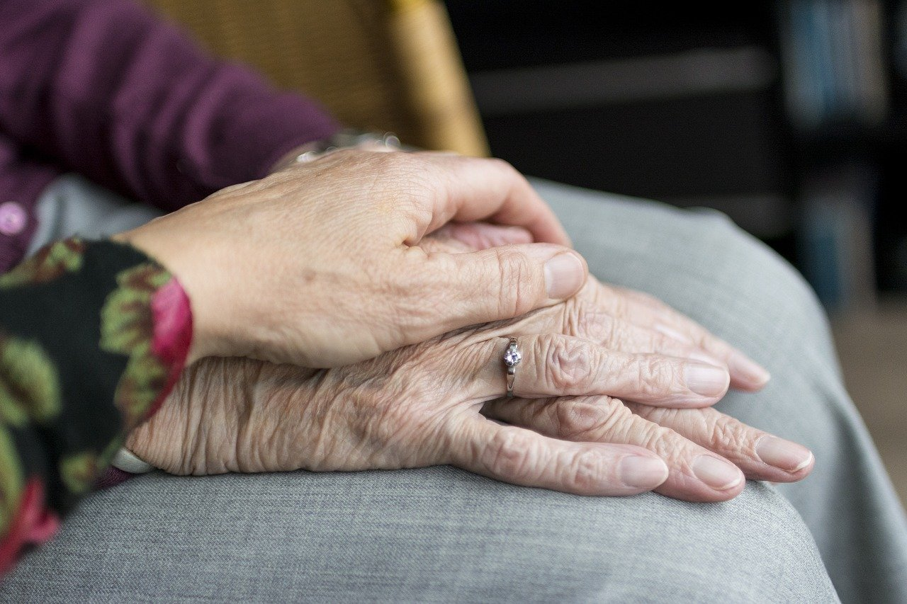 Image of two people holding hands